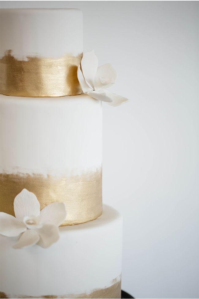 The gallery of 38 flower adorned wedding cakes with elaborate decor details_ These amazing wedding cake ideas are perfect for a Spring wedding.jpeg