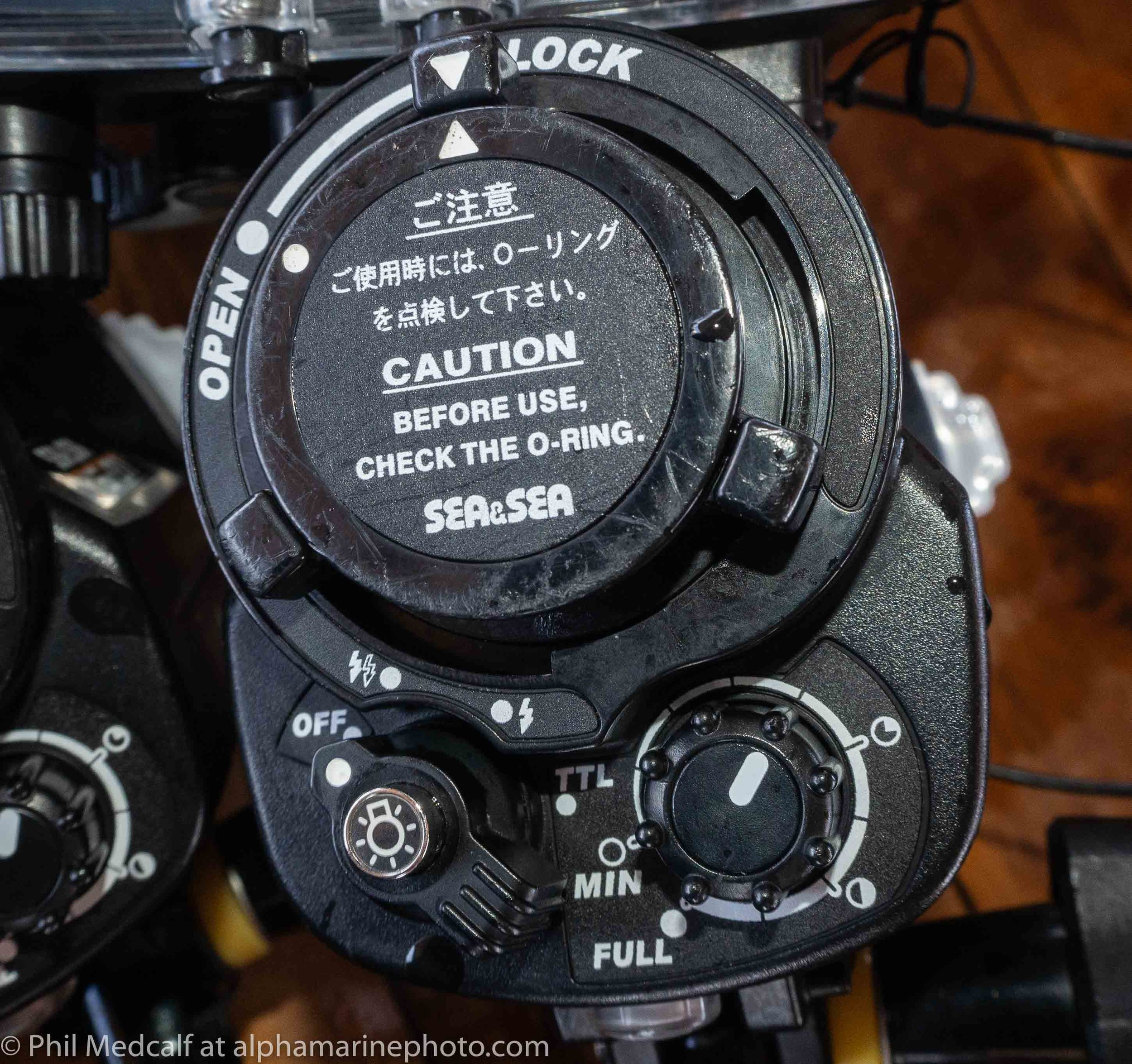 Controls on the back of a Sea & Sea YS-01. The two lightning bolts on the left hand dial is for when using with preflash on your camera and the single solid lightning bolt is without preflash. When using your camera's flash set to manual (if it lets you) it won't fire a preflash.