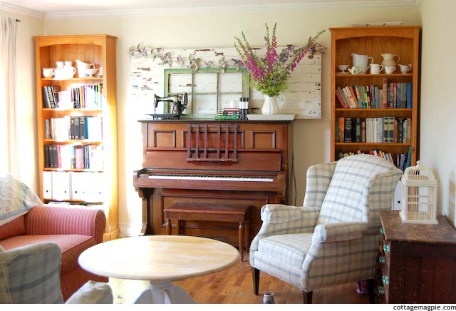 Living Room with Piano Decorated Like Mantel
