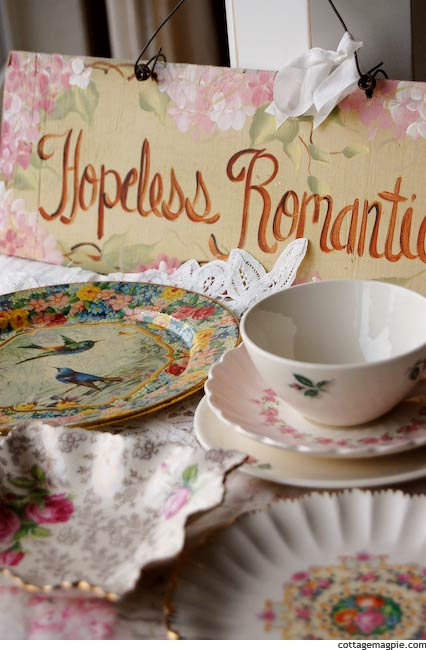 Floral Dishes and Hopeless Romantic Sign