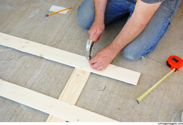 Tacking Down the First Paneling Strip for the Faux Door