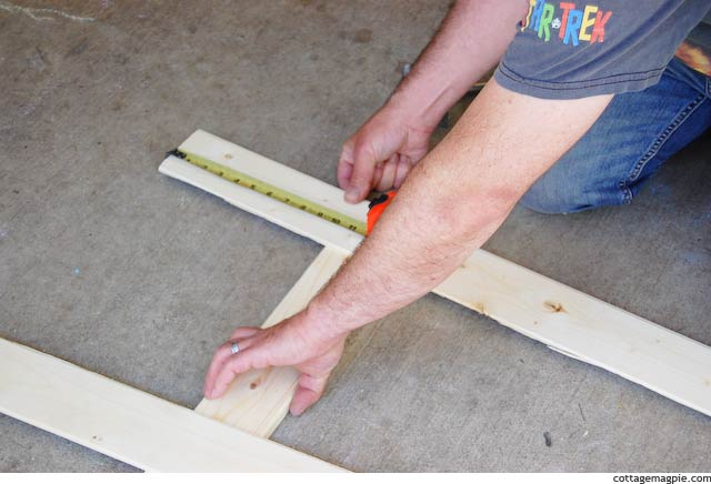 Measuring the Other End of the First Paneling Strip for the Faux Door