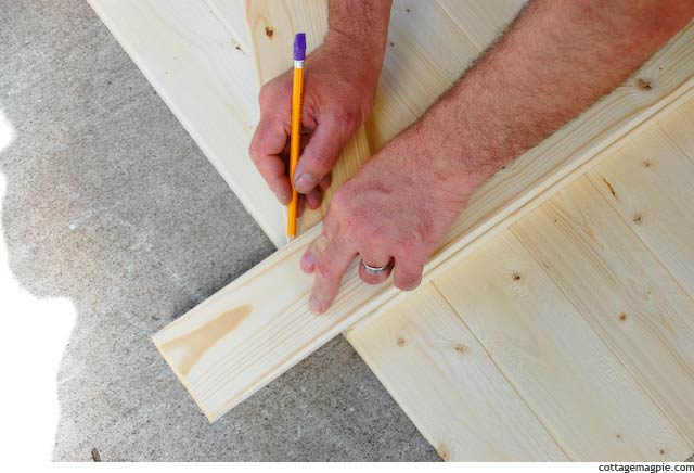 Lining Up a Scrap Board to Mark the Angled Cut on the Faux Vintage Door