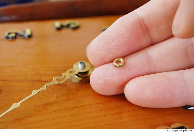 Tiny Nut that Holds Hands on Battery Operated Clock