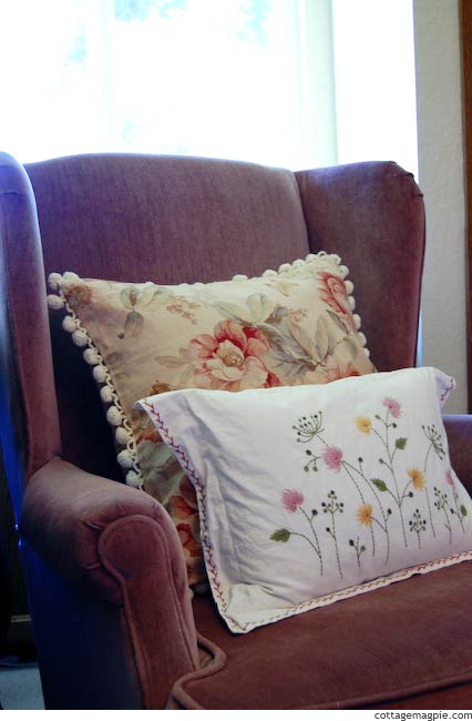 Mauve chair with floral pillows