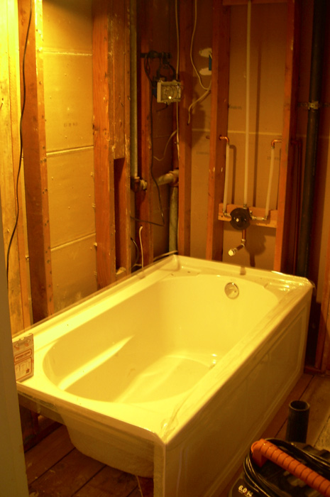 Gutted Bathroom With New Tub