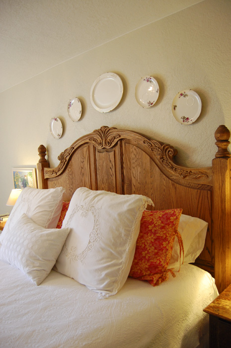 Carved Oak Panel Bed With Plates Above