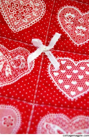 Tied Ribbon Bows on Thrifted Red Heart Quilt
