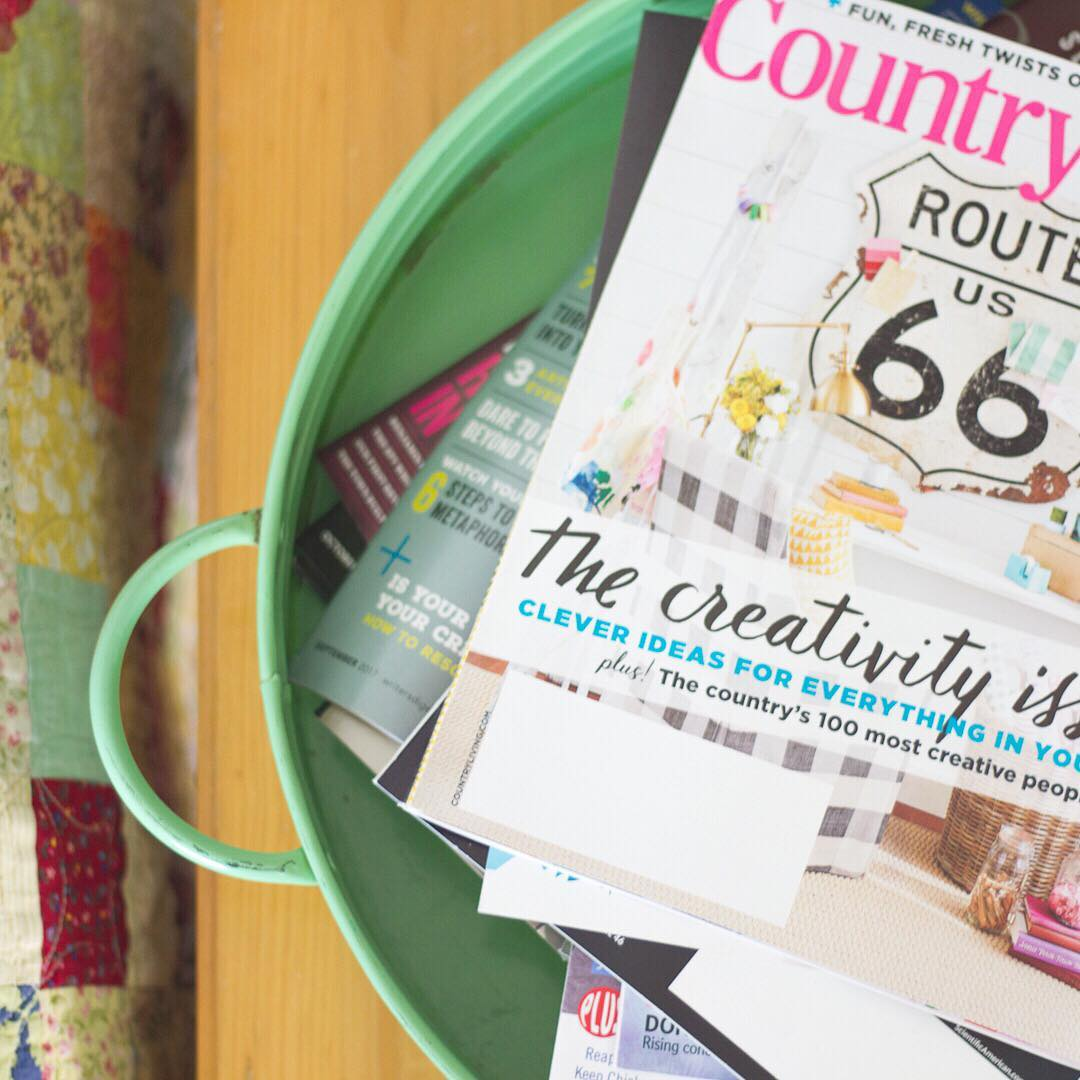 Country Living and a Stack of Magazines - via www.cottagemagpie.com