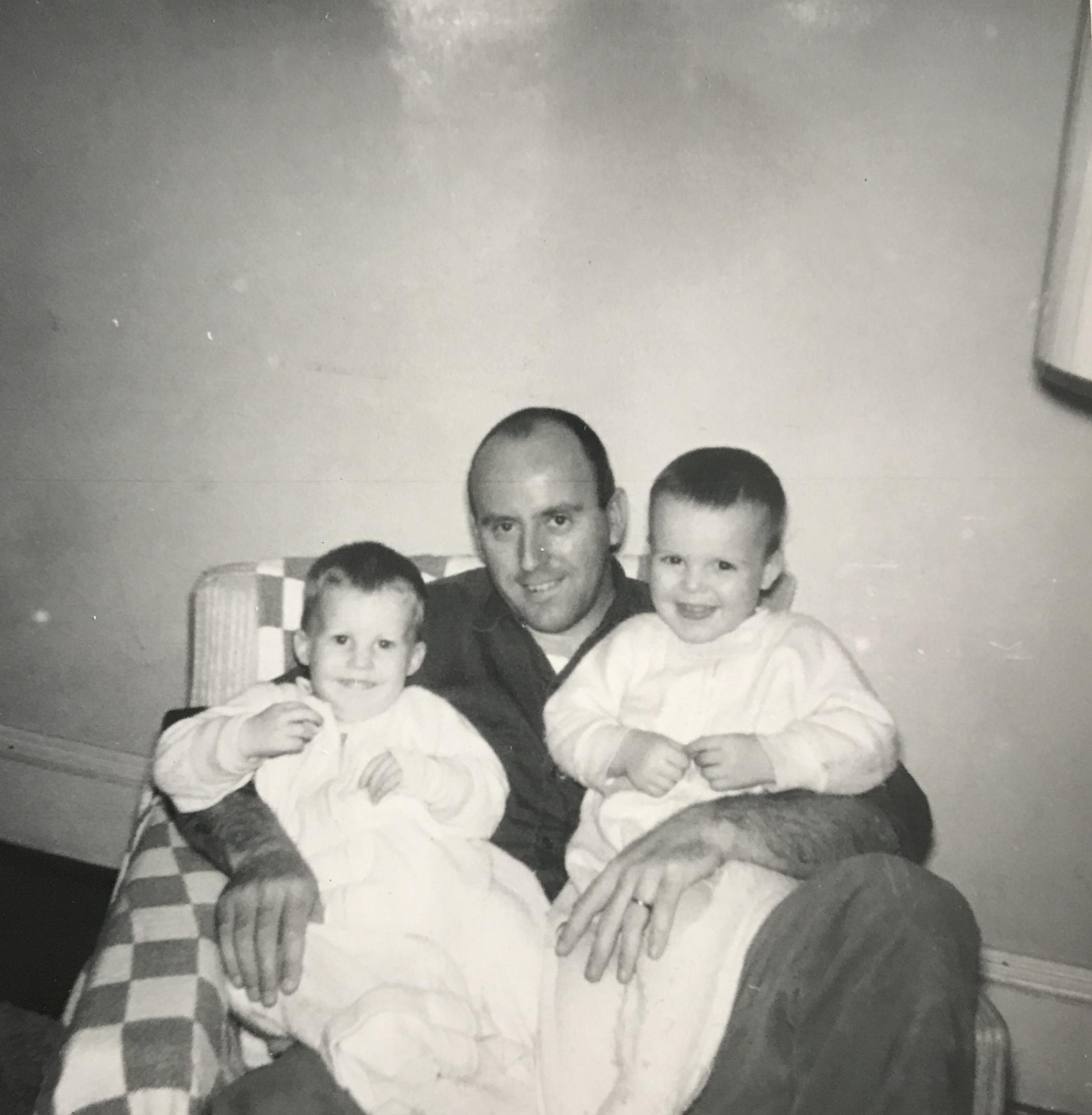 Dad holding me and my brother Dave.