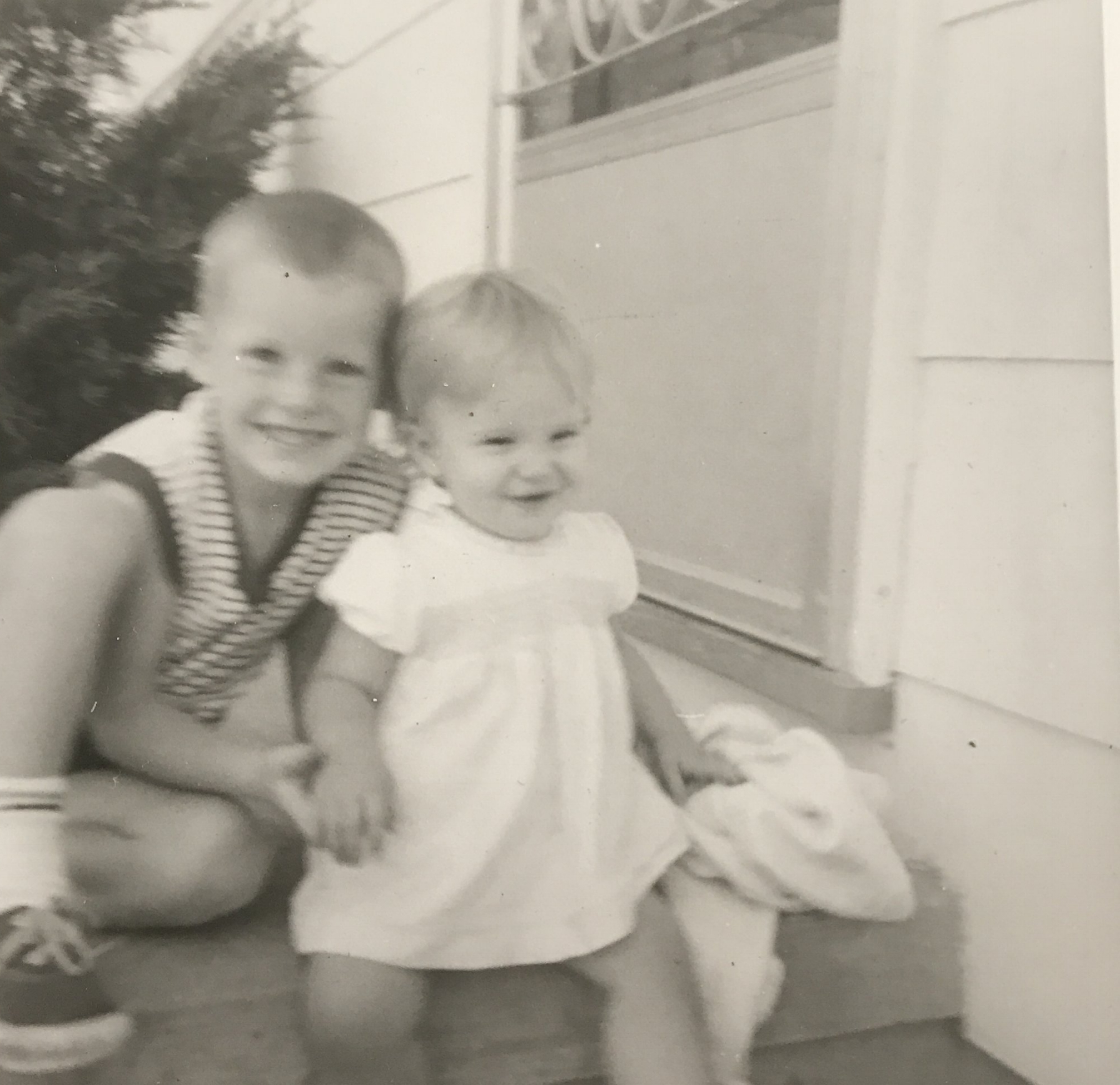 Me showing off my baby sister on our porch.