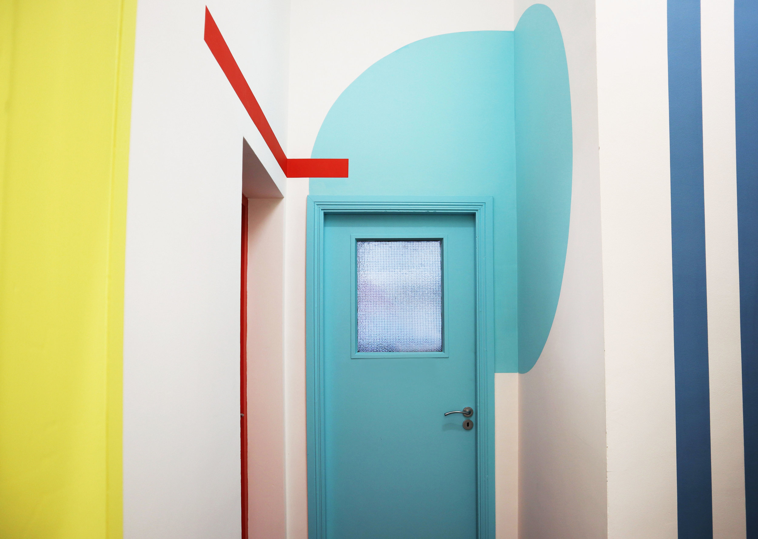 Pointy hallways, with bright geometric shapes.