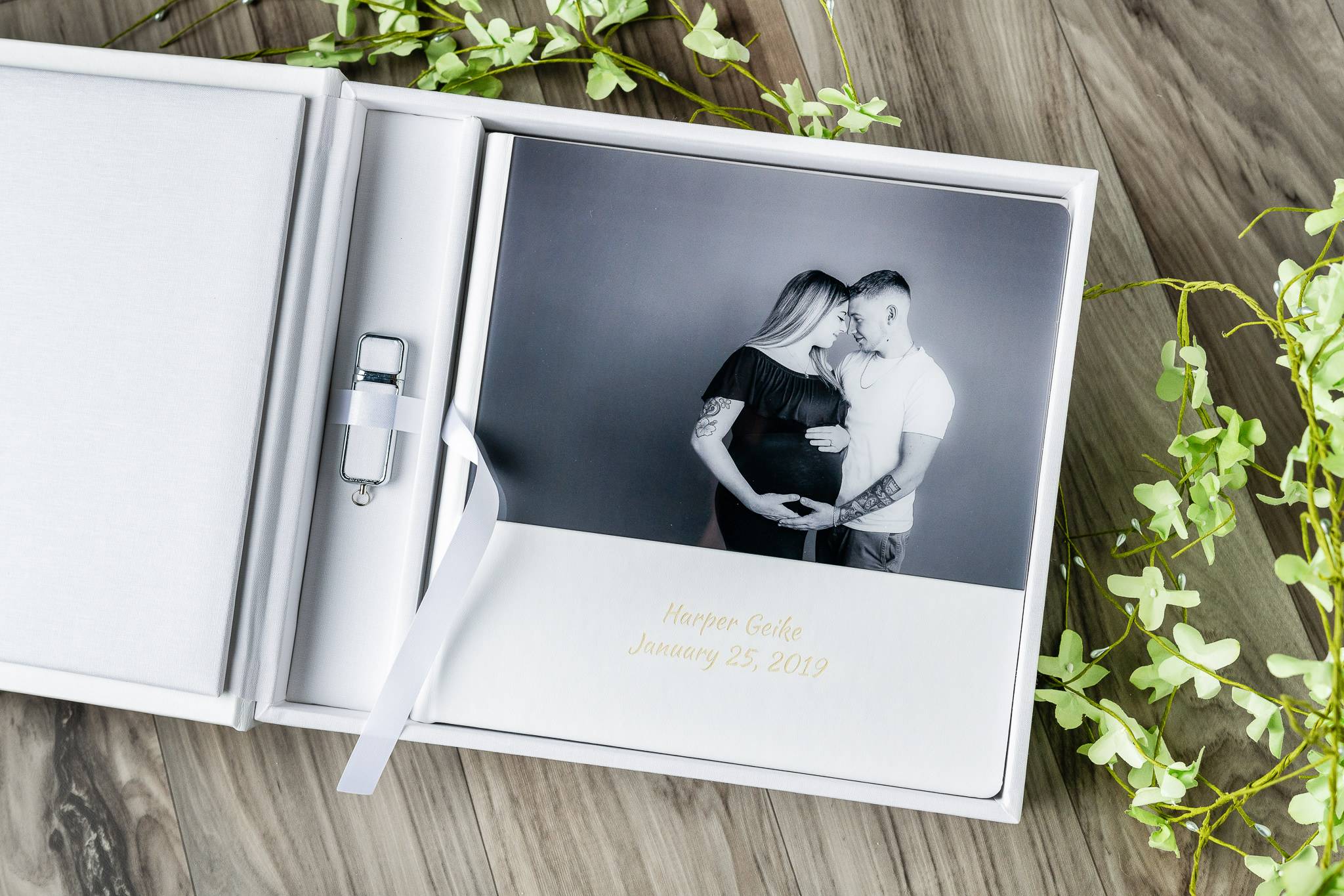 Keepsake Heirloom Collection - A beautiful acrylic album with a matching cover. Personalize the front with your special occasion! This keepsake album comes with 25 portraits and the matching digital portraits on a USB.Starting at $799