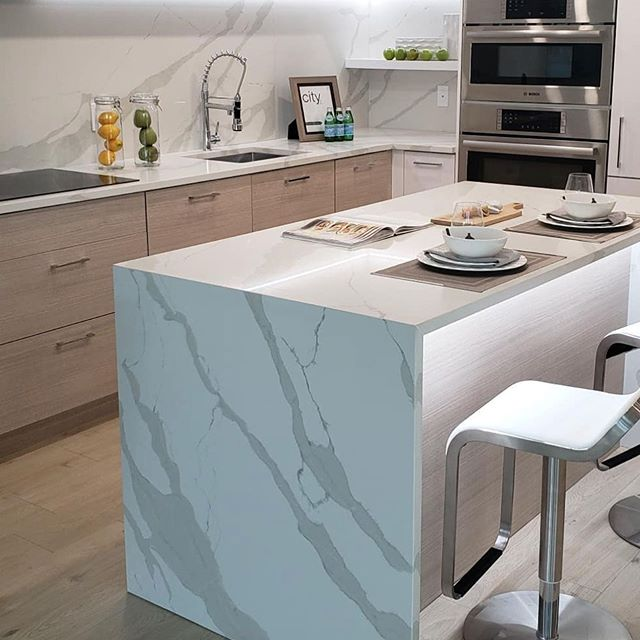 The waterfall you want to chase with #tomstonequartz Calacatta series. Turn your kitchen into a masterpiece. . www.tomstonequartz.com . #quartz #quartzcountertops #kitchen #kitchencountertops #interiordesign #stone #stonecountertops #design #designinspiration #countertopdesigns #canada #vancouver #renovation #inspiration #tomstonequartz