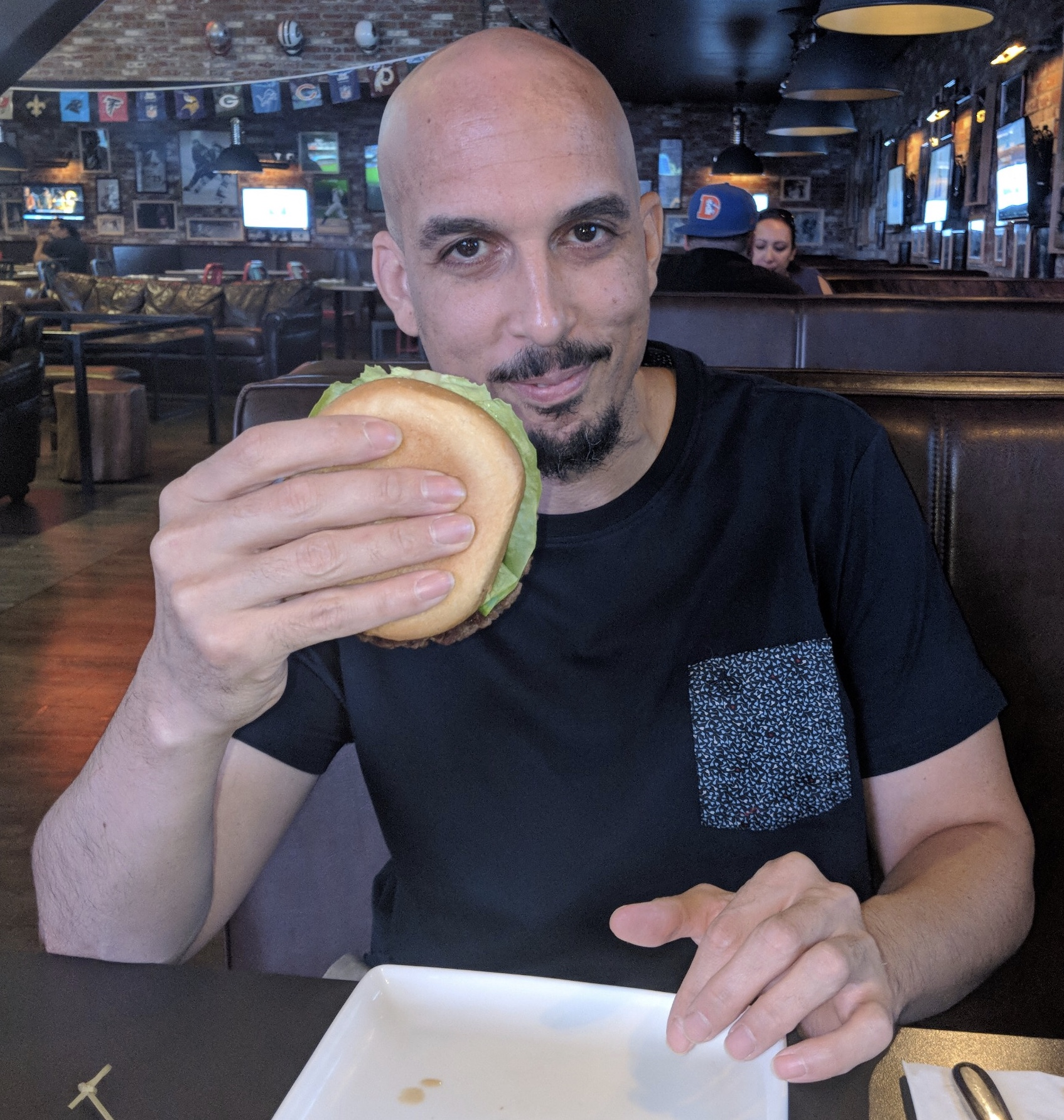 "Jason proudly displaying his Impossible Burger, a symbol of the ""Plant-Based Revolution"""