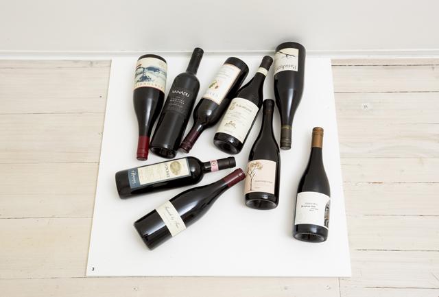 GEORGE- EGERTON-WARBURTON  The camera's worth various bottles of red wine  2013