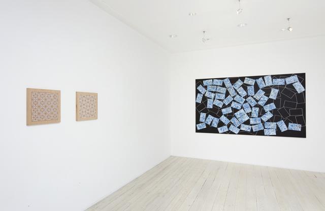 Installation view of Adiran McDonald's paintings