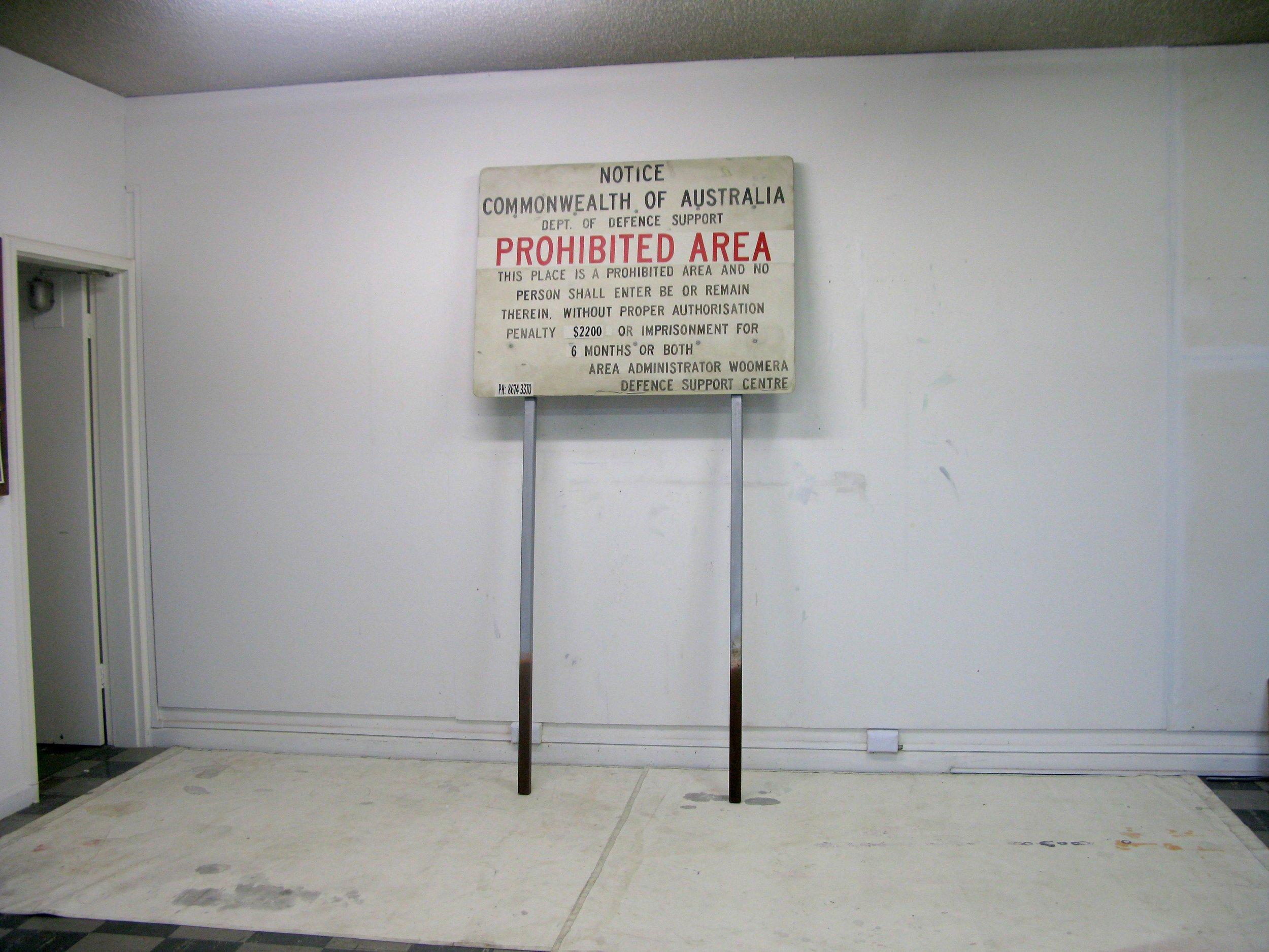 ADAM NORTON  Prohibited Area  2010  acrylic on board, PVC pipe, metal poles dimensions variable