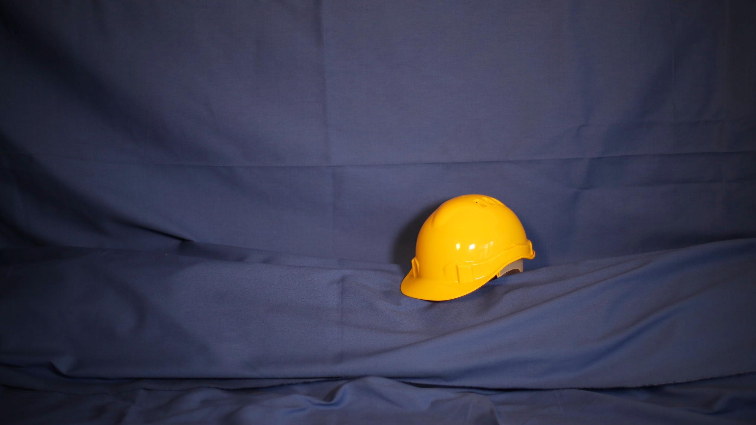 Le bleu de travail et le casque
