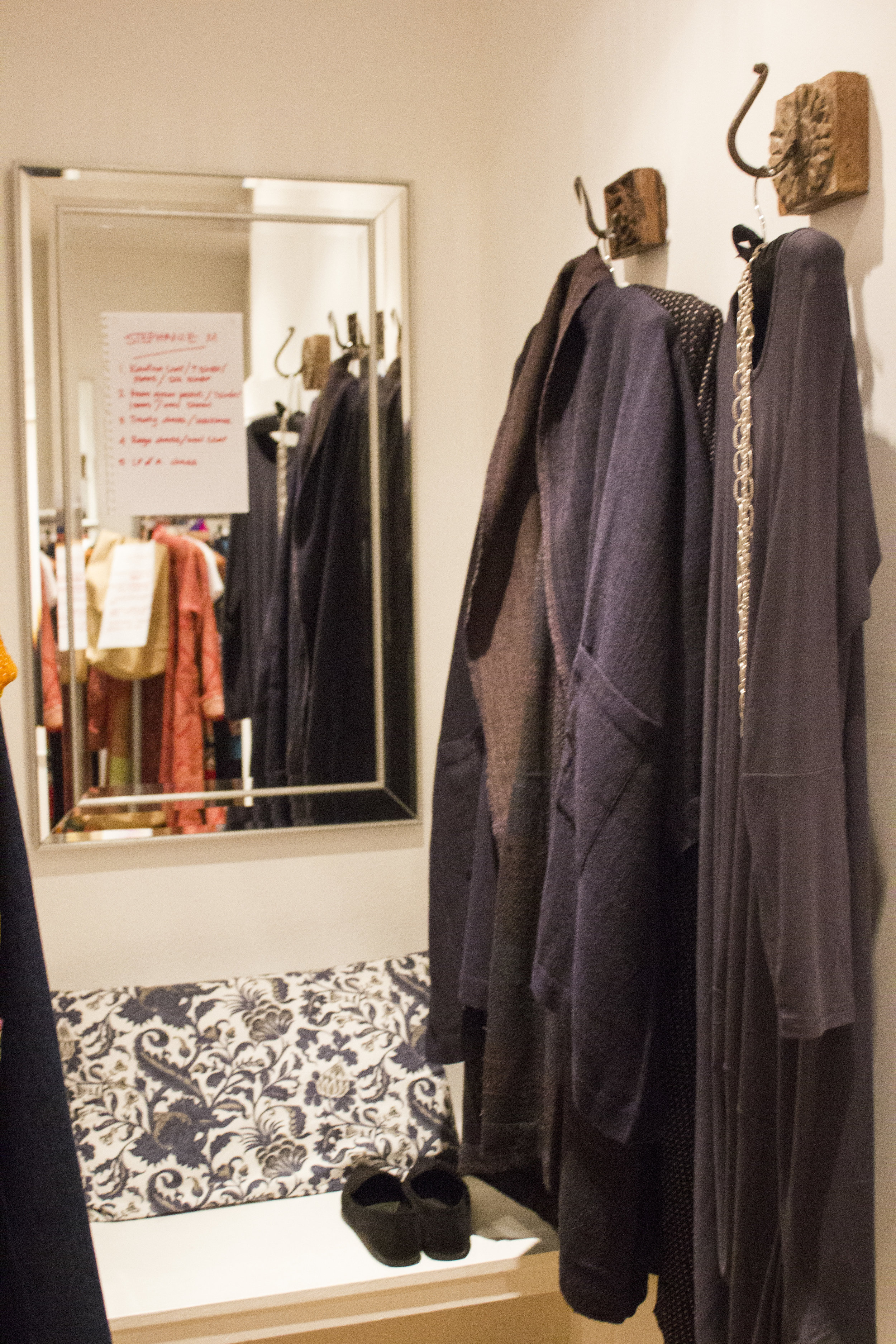 The dressing rooms with outfit running order on mirror
