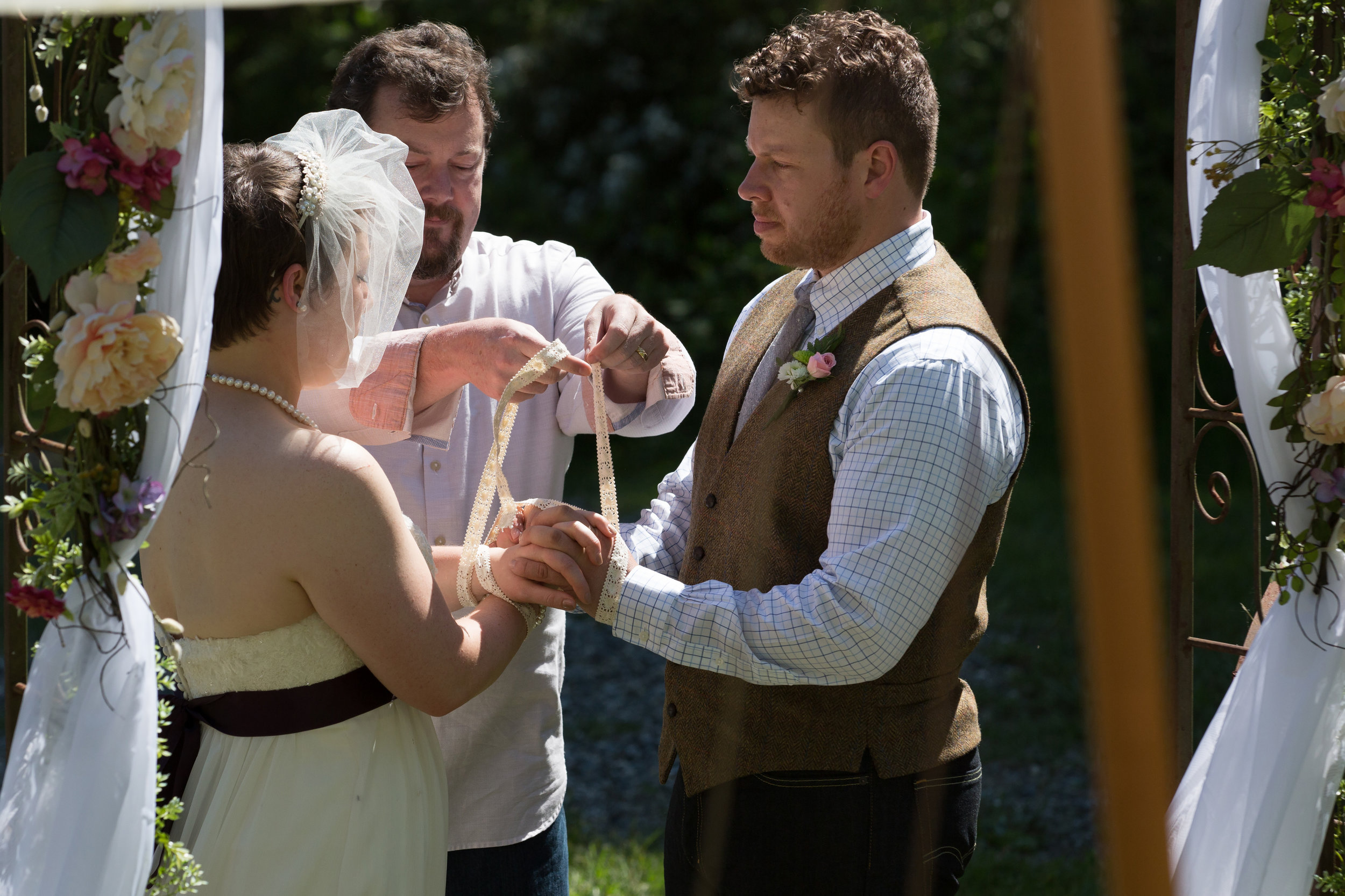Literally tying the knot. The hand fasting signifies the joining of the two spirits while the rings signify the physical joining of the couple. Both traditions were included in this ceremony. Photograph courtesy of Mike and Barbara MacLeod of Studio MacLeod,http://www.studiomacleod.photos/