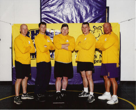 Rhino Wrestling Club Coaches. Me in the center, still on active Duty. Left to right Mark, Steve, Me, Charlie, and the legend Chuck Smith.