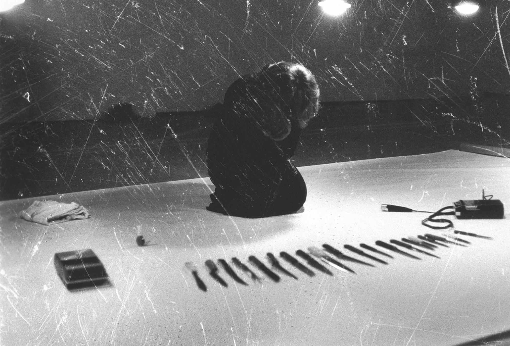 Marina Abramovic performing Rhythm 10