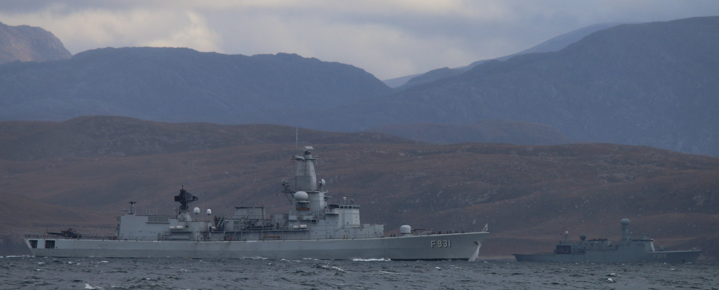 Military vessels engage in training exercises during Joint Warrior operations in the Hebrides