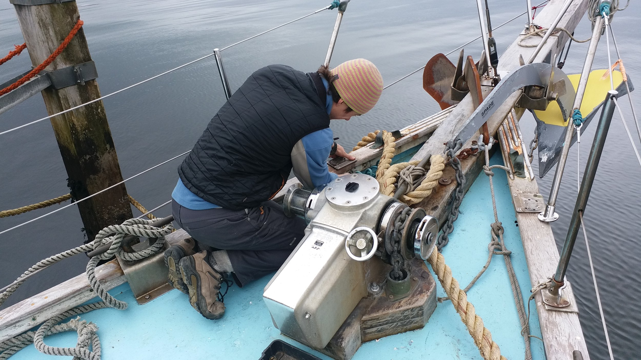 All hands on deck! Simon carrying out some maintenance.