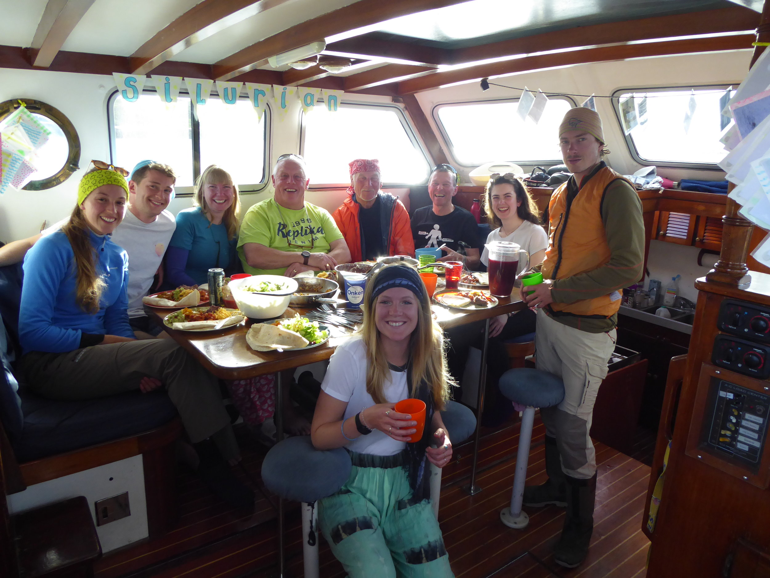 Volunteers and crew enjoying a meal together after a hard days work