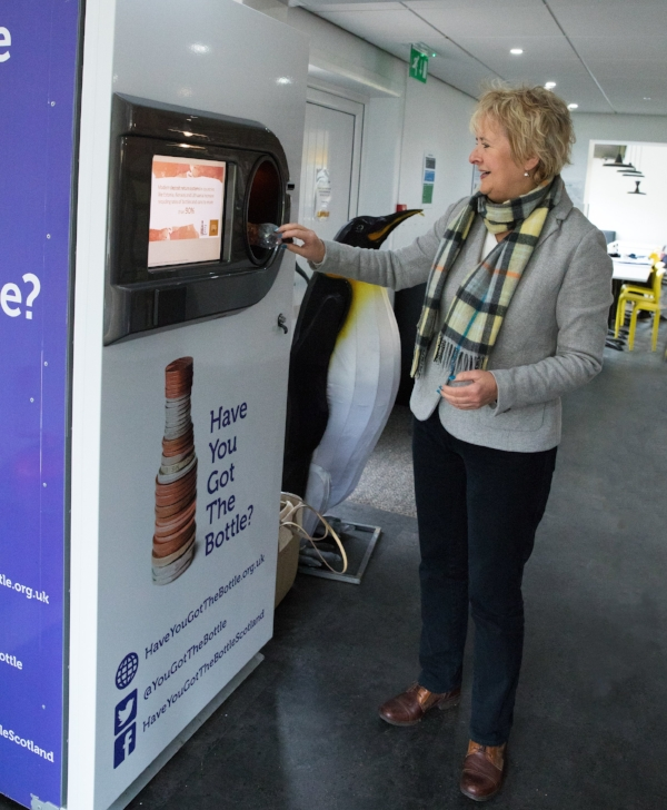 Roseanna Cunningham, Cabinet Secretary for Environment, Climate Change and Land Reform, trials a reverse vending machine at Edinburgh Zoo.