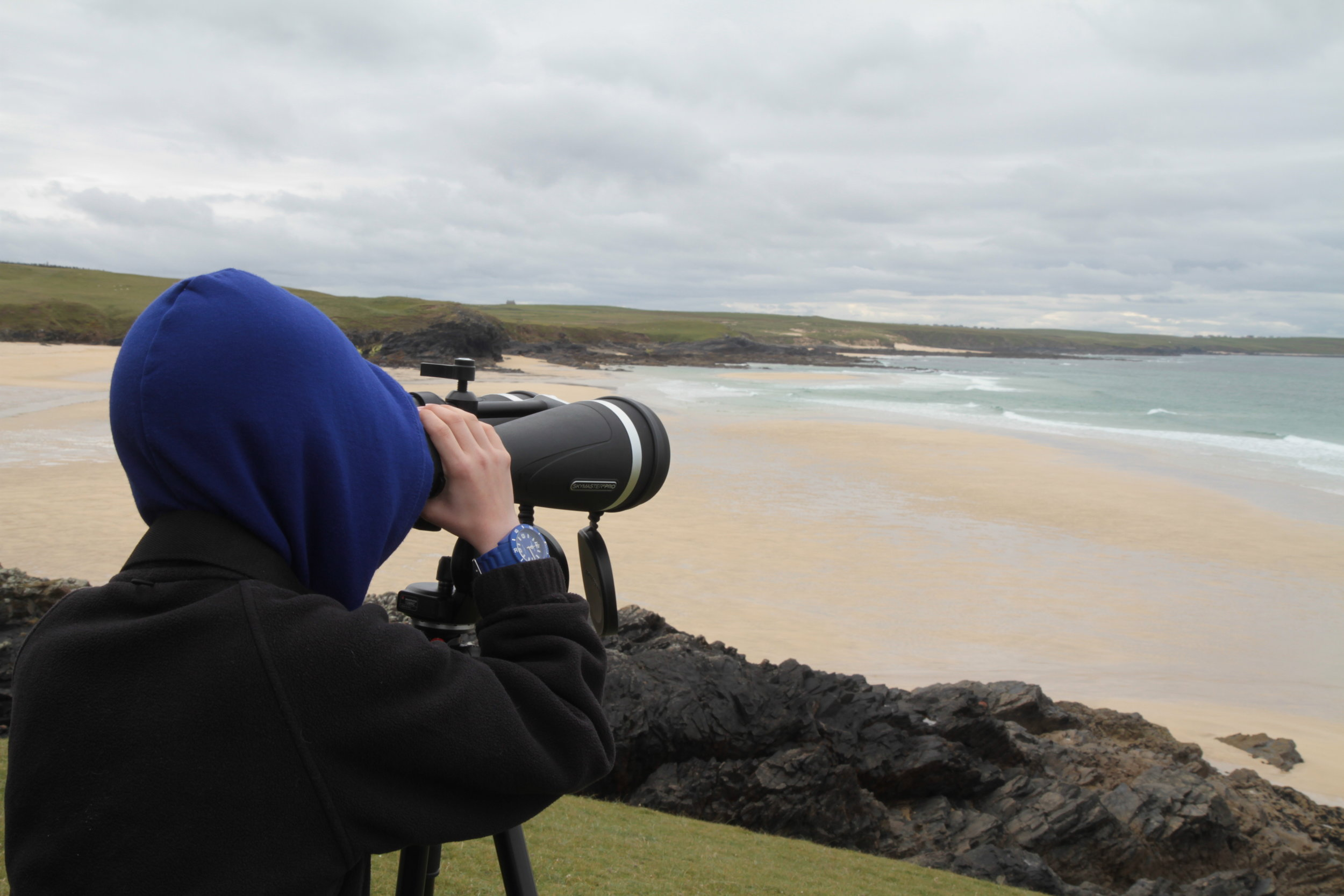 Pupil from a past school visit takes part in a headland watch.