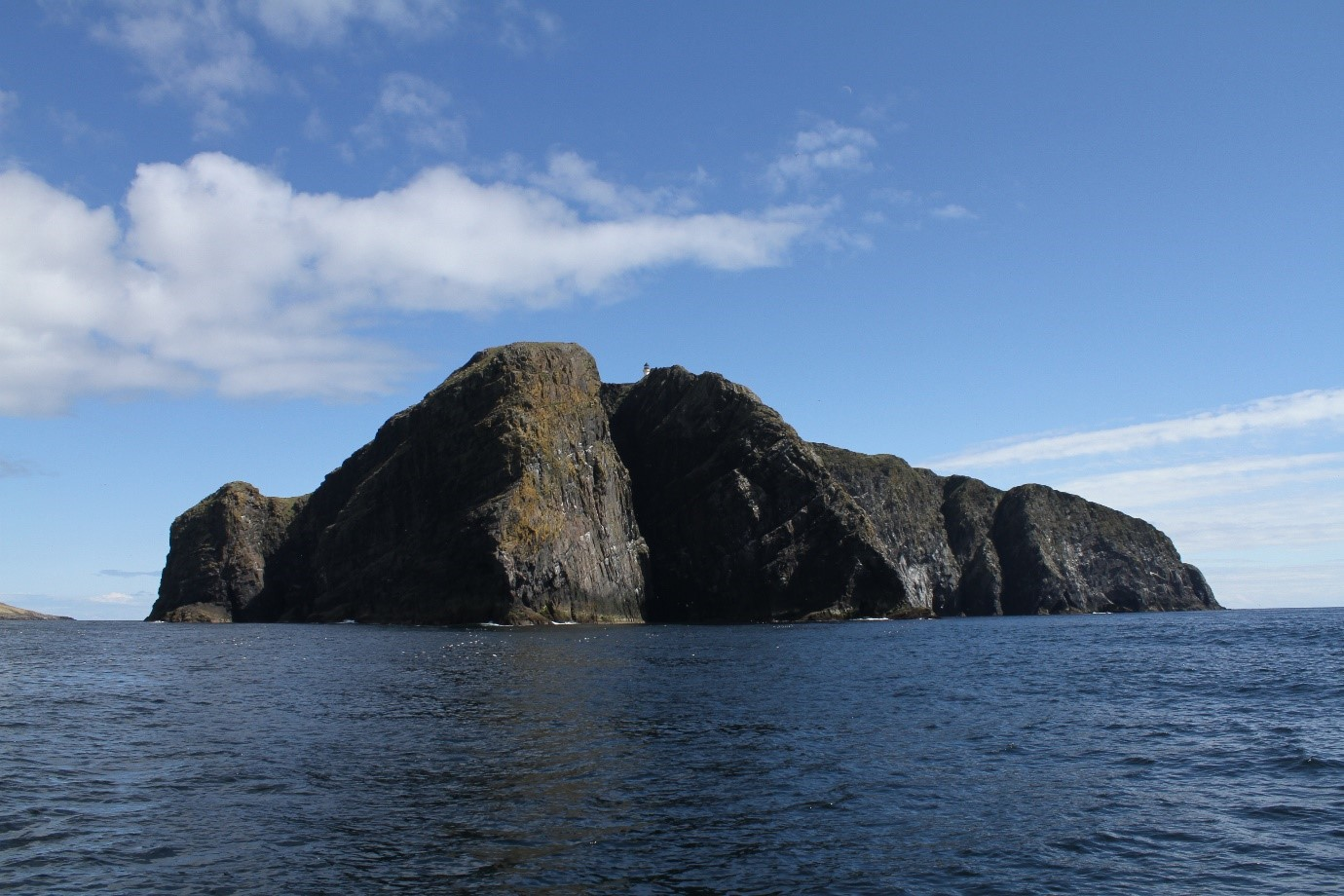 Sailing past Barra Head