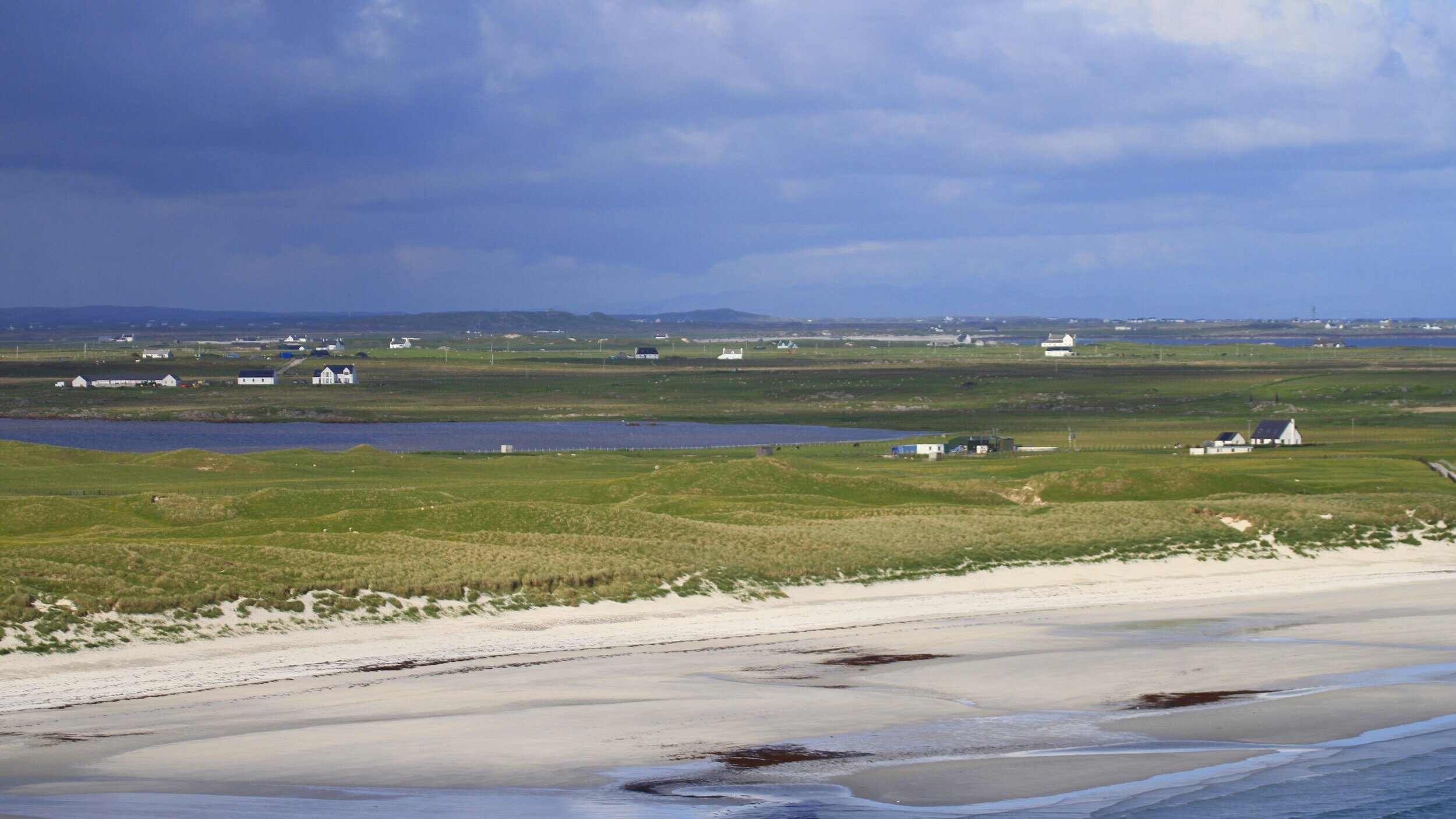 Looking east across Traigh Bhi, you can see sand-blow through the dunes.