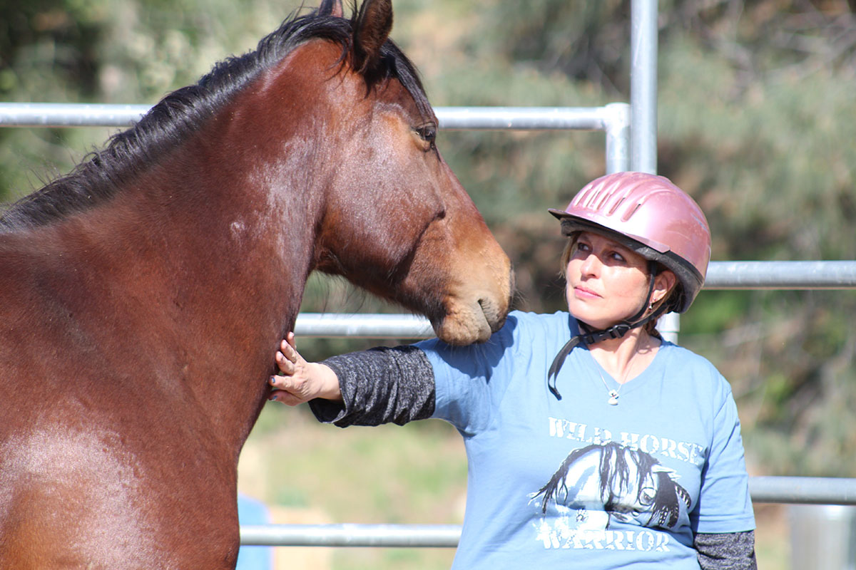 Barbara had never been up close with a horse before- let alone a wild rescued mustang. This is her trusting herself, and letting herself be open to the horse… and the horse responded in kind.