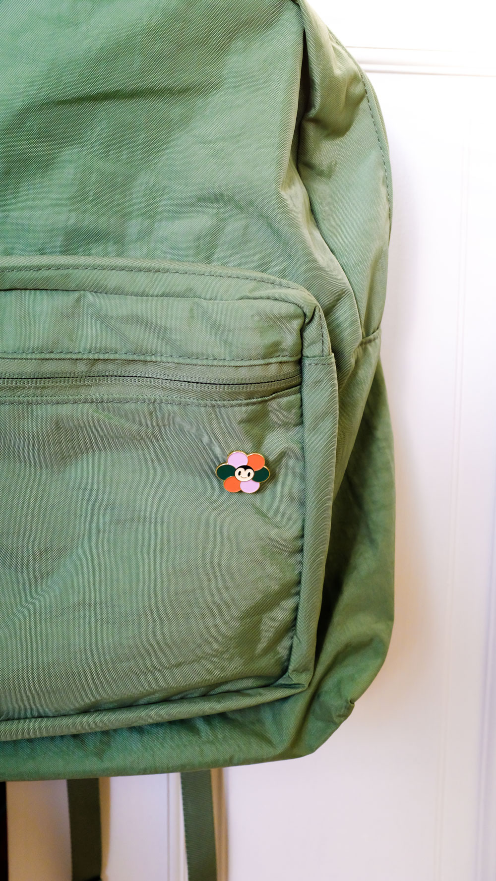 I just realized how much orange and green I own. I do love me some oranges and gardens so it makes sense. This cute pin is from  Hannah Kristina Metz . Bookbag from  Baggu . I always love what they come up with.