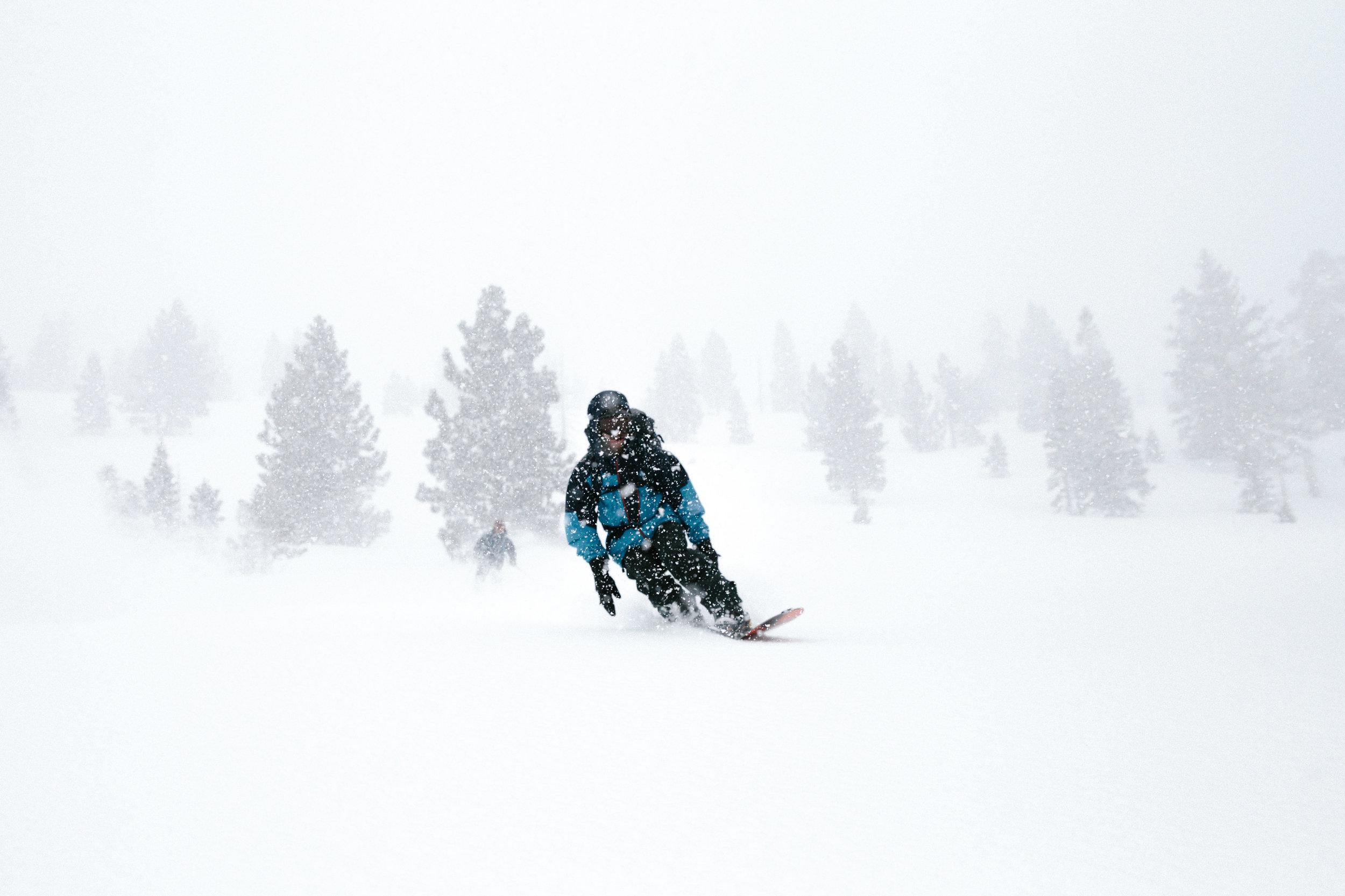 Snowboard through powder
