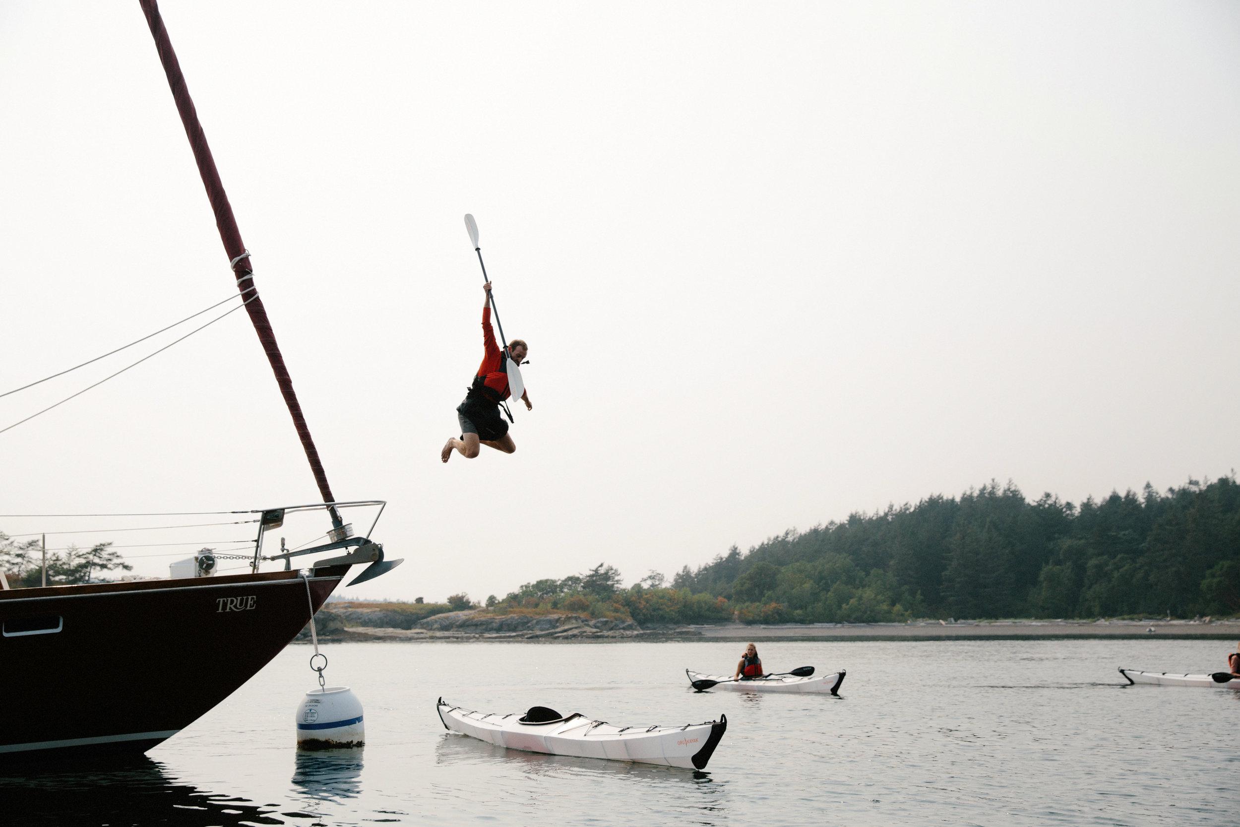 Jumping off sailboat