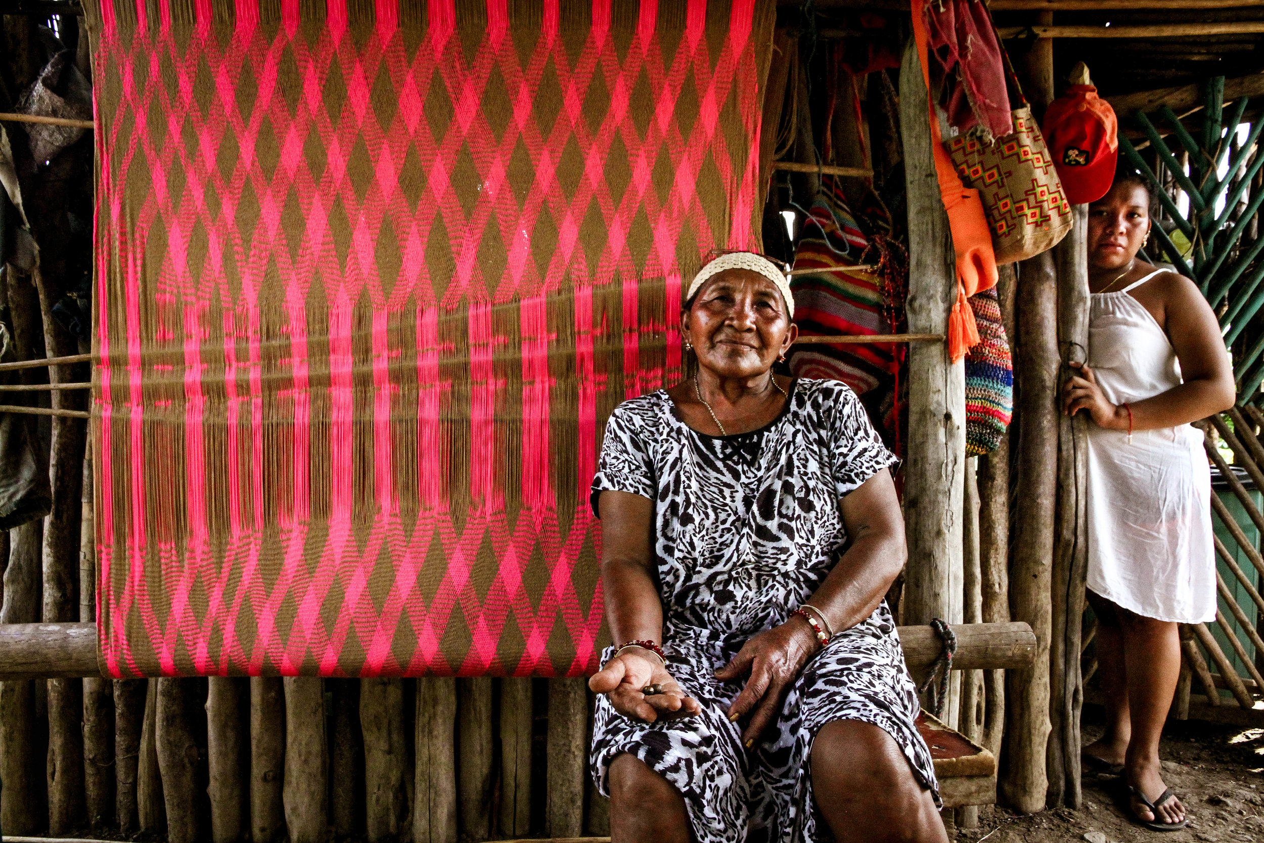 Wayúu healer and granddaughter from the Tamaquito II community, displaced by the Cerrejón coal mine in La Guajira, Colombia.