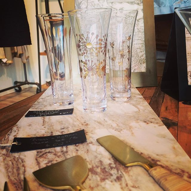 Gold etched holiday glasses, cheese boards, cheese knives