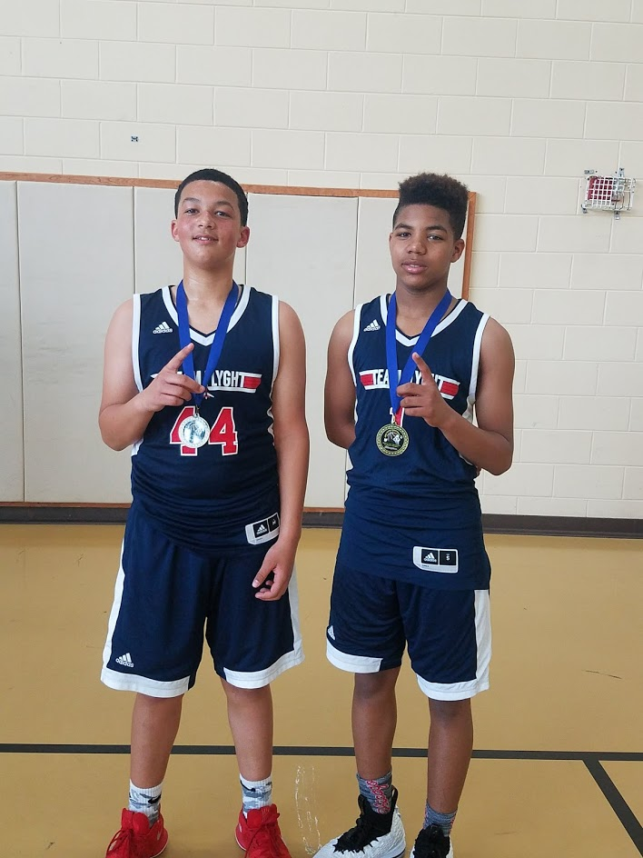 Issiah Evans (left) with his basketball teammate