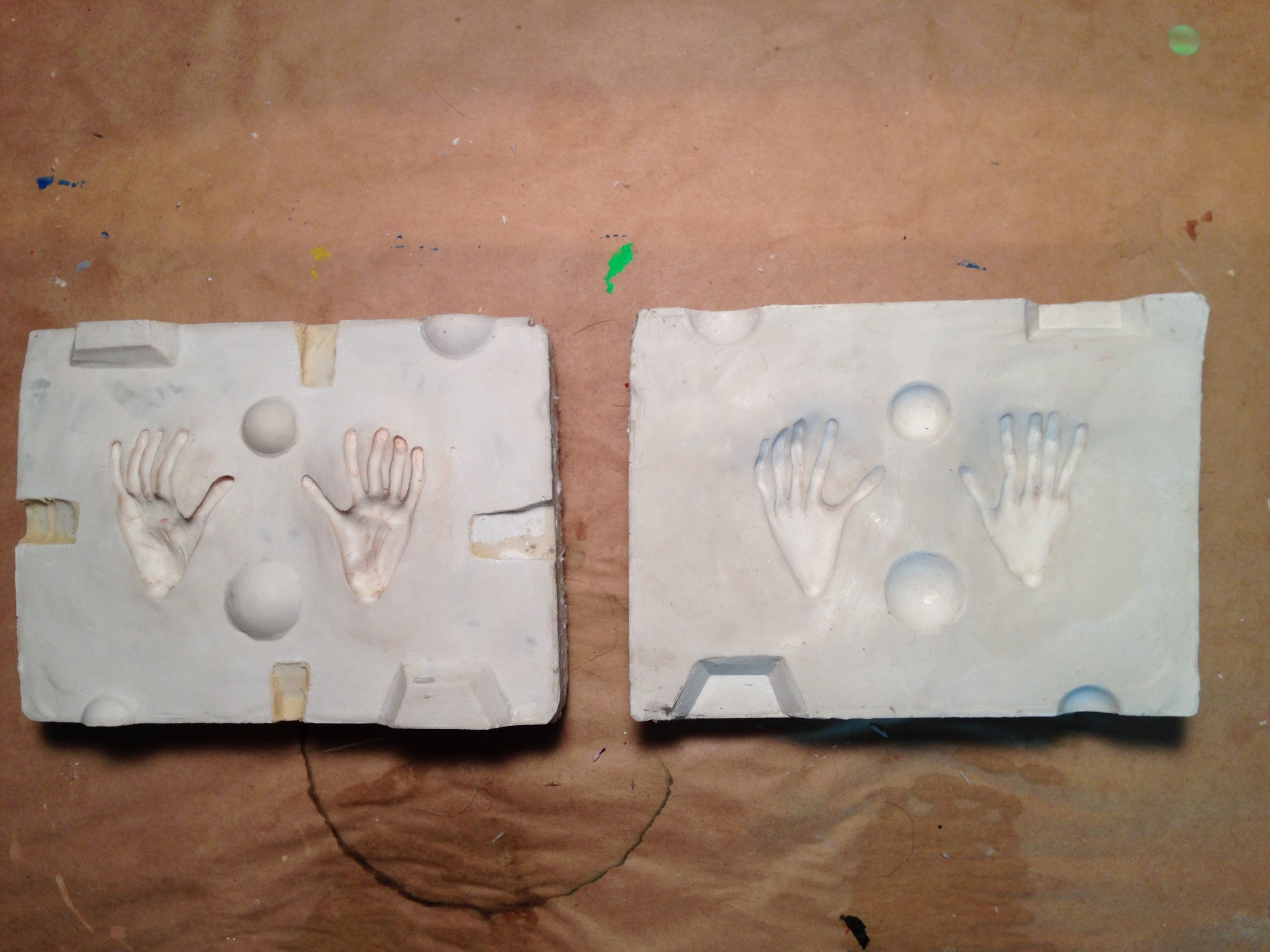 Molds for casting silicone lemur feet.