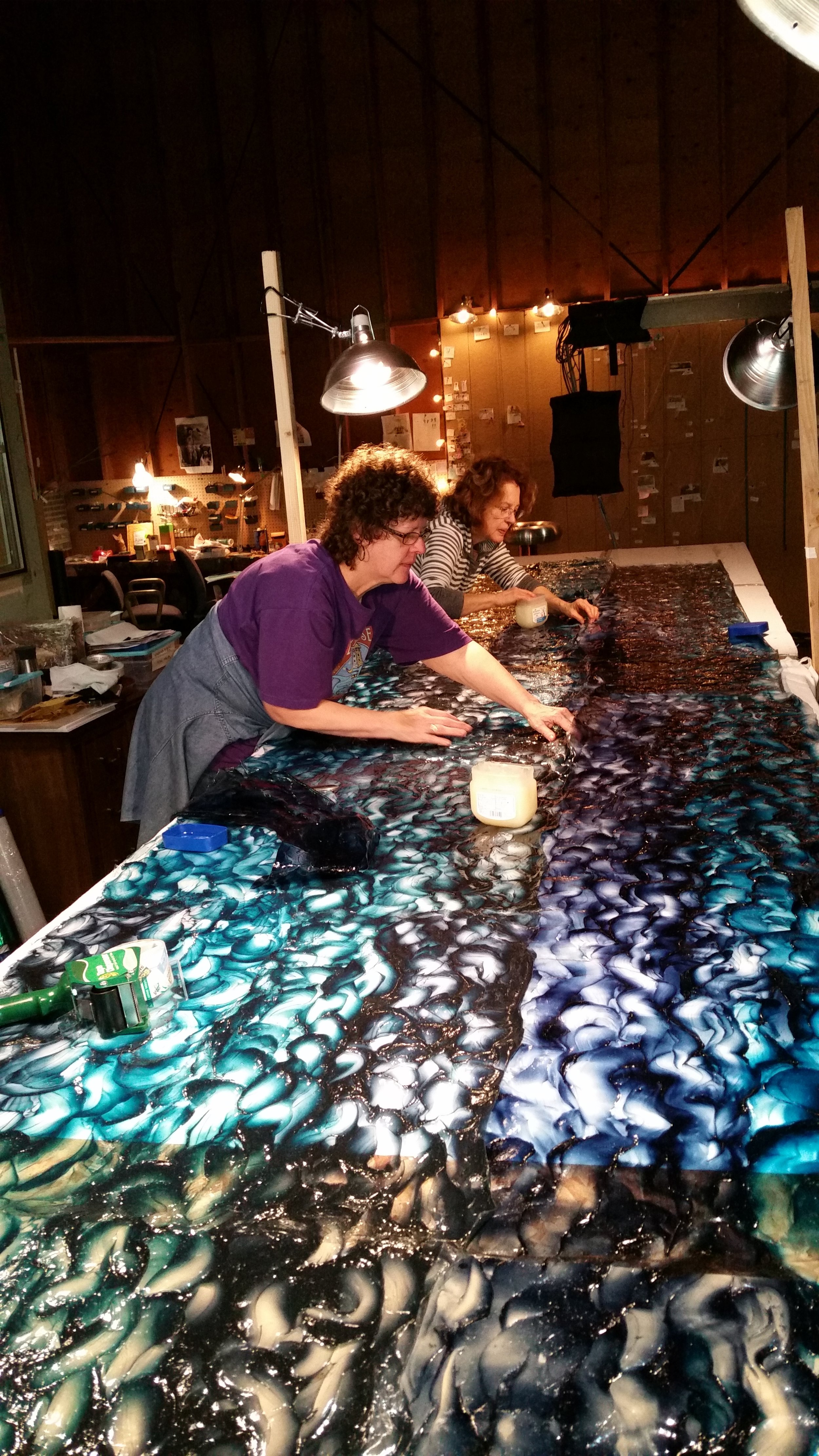 Beth Gavigan and Elicia Beebee adding texture to the artificial water.  Photograph by Kathleen Chamberlin