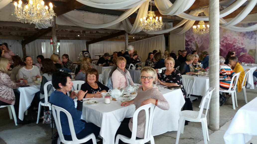 55 lovely ladies enjoying the High Tea