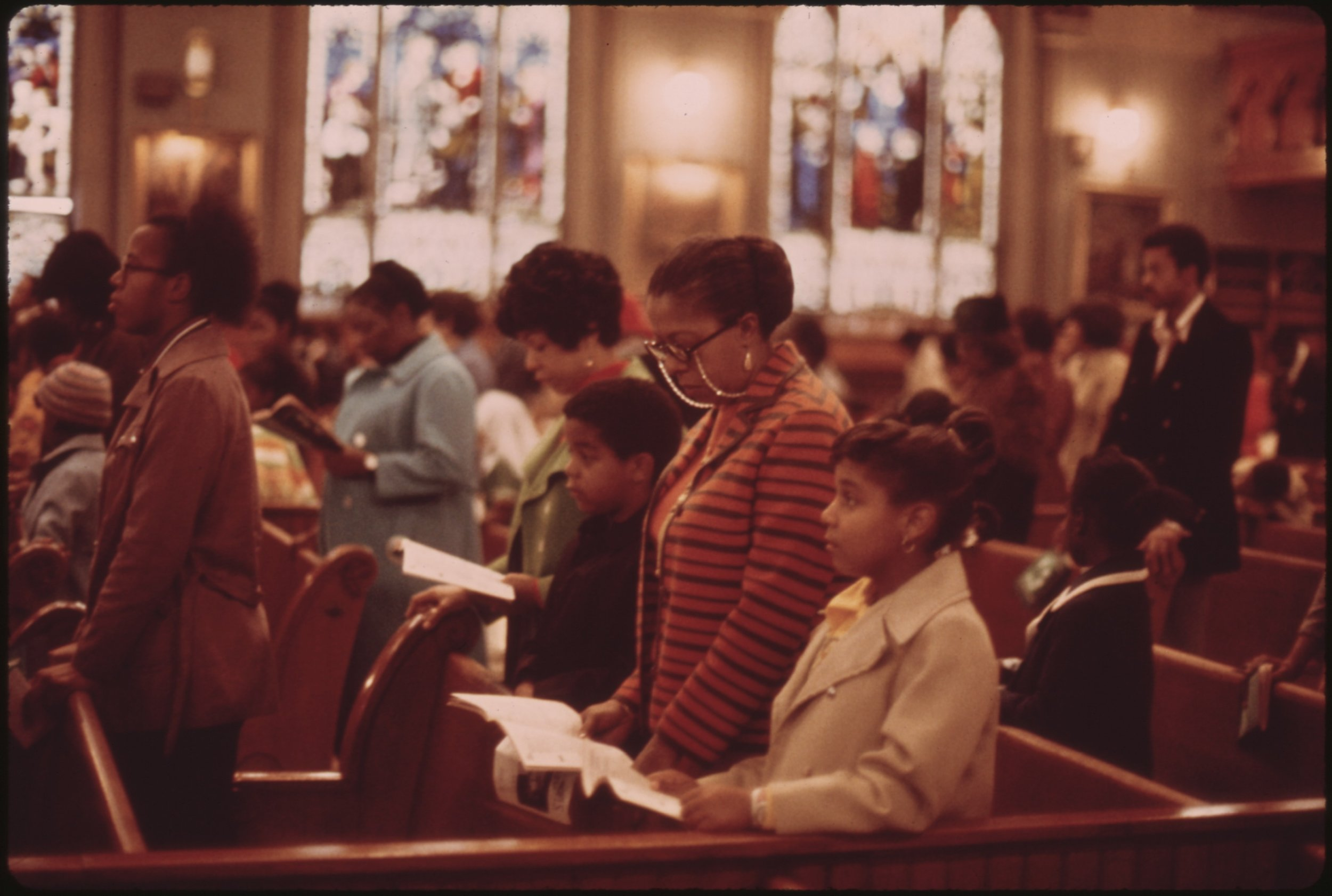 WORSHIPPERS_AT_HOLY_ANGEL_CATHOLIC_CHURCH_ON_CHICAGO'S_SOUTH_SIDE._IT_IS_THE_CITY'S_LARGEST_BLACK_CATHOLIC_CHURCH...._-_NARA_-_556238.jpg