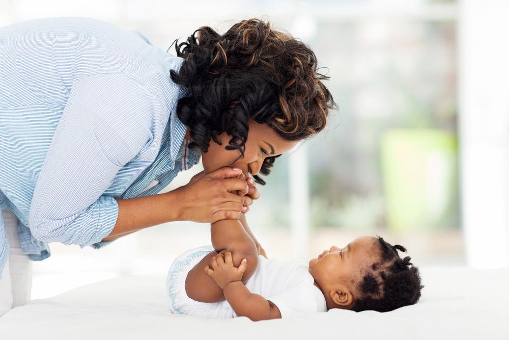 LAD-pics-mom kissing baby feet.jpg