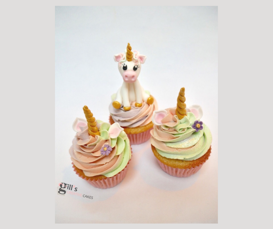 Unicorn Cupcakes with miniature edible unicorn cake topper
