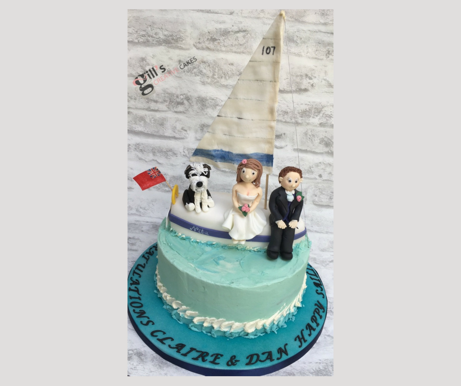 Bride and groom with their dog on their boat cake