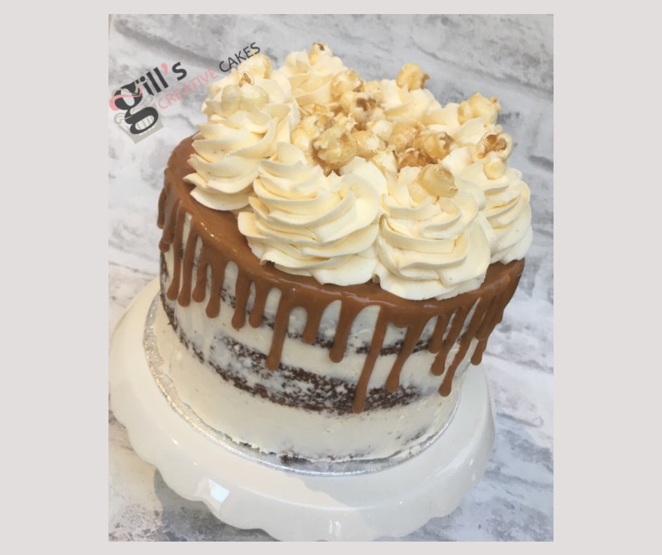 Sticky Toffee Cake with Salted Caramel Drip and decorated with popcorn