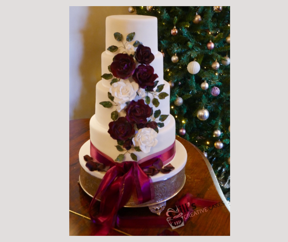 Ruby and White Winter wedding cake 3.png